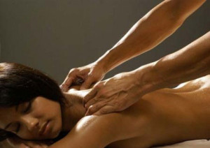 Massage of a woman by a man